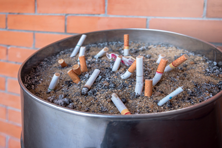 Smoked Cigarettes Butts in ashtray Stock Photo