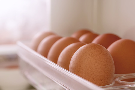 Close up fresh eggs on a tray in refrigerator,shallow DOF Stock Photo