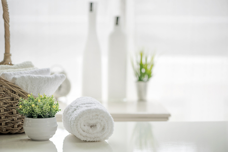 White towels on white table with copy space on blurred bathroom background. For product display montage. Imagens - 104547362