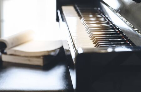 Piano keyboard background with selective focus and sunlight. Copy space.