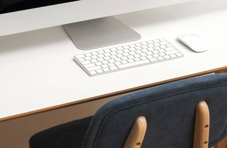 Cropped image of desktop computer on white table with blue chair. White keyboard, white mouse.