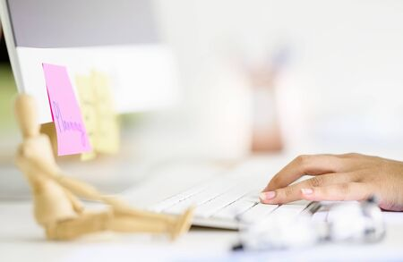 Closeup female hand typing on white computer keyboard, copy space. Standard-Bild