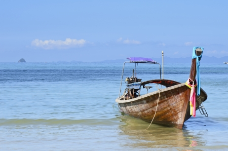 This is a landscape photo of a long tail boat at Aonang Krabi Thailand This photo was taken in the morning