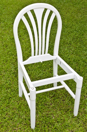 uncomplete:  Uncomplete White Chair on Green Grass.I painted this chair by myself. Stock Photo