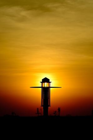 A photo of Lamp post with sunset.This photo was taken on the parking building. Stock Photo - 16176412