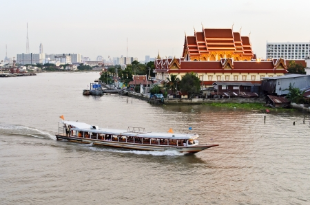 A photo of Wat Wimut and Chaopraya Boat.This photo was taken at Rama 6th Bridge. Stock Photo
