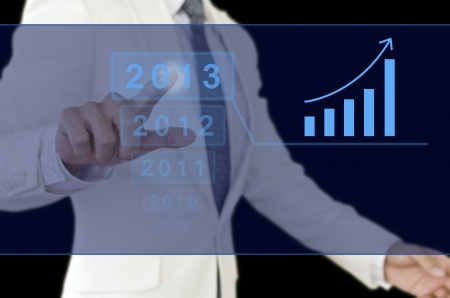 Businessman point to 2013 chart. Stock Photo - 16734168