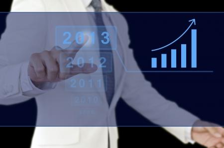 Businessman point to 2013 chart.  Standard-Bild