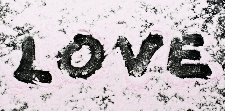 pink powder love alphabet on black background photo