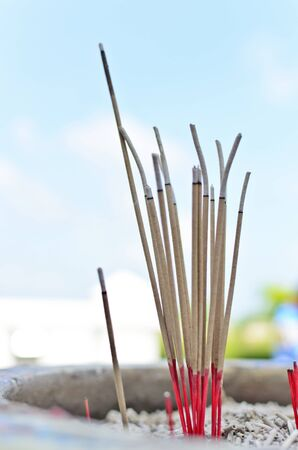 red incense on blue sky Stock Photo