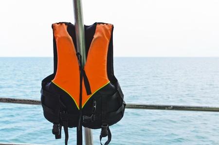 orange Life jacket and sea
