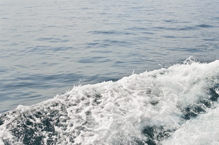 Sea foam at right side of boat Stock Photo - 17656716
