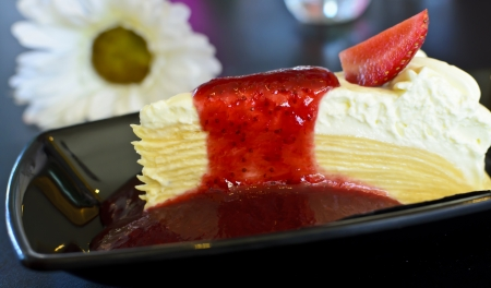Crape cake topped with strawberry jam. photo
