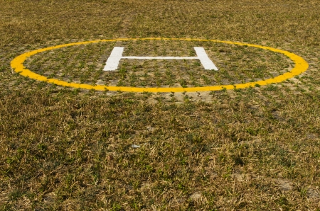 helicopter pad: Helicopter landing pad on grass
