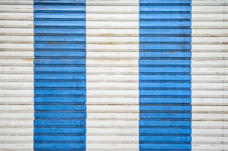 white and blue strip on metal door photo