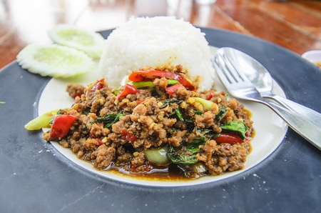 Thai food Thai spicy food, Fried pork with sweet basil photo