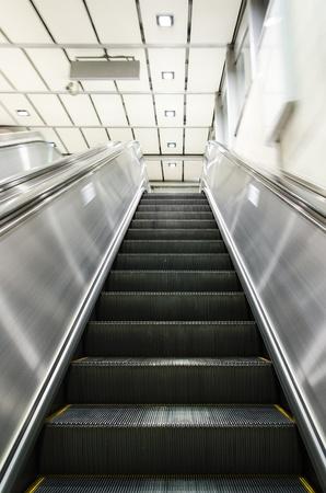 Escalators in motion photo