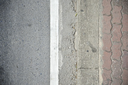 asphalt road and sidewalk photo