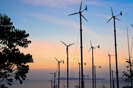 small Wind turbines in the sunset