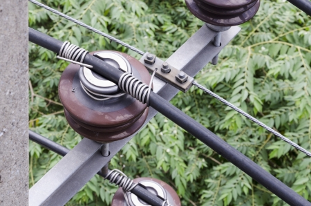 closed up electrical insulator on elecrical pole Stock Photo