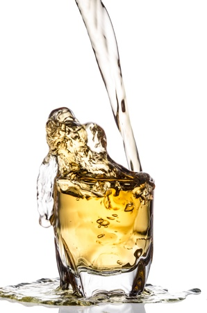over flow pouring whiskey isolated on white background