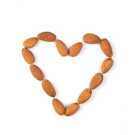 microelements: almond nuts in macro isolated heart shaped