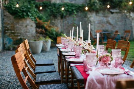 Table set for wedding or another catered event dinner in pink color
