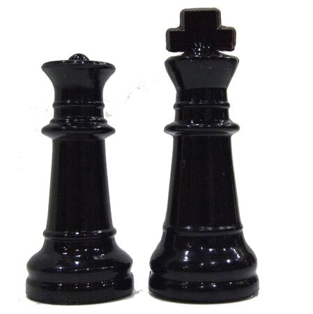 Black chess pieces, king and queen, on white background