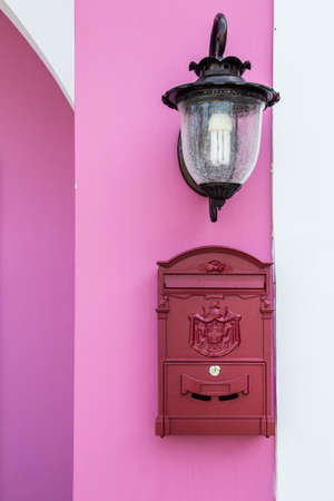 Red Mailbox on the pink wall photo