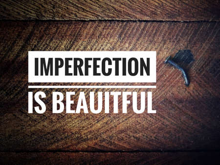 Motivational and inspirational quote - Imperfection is beautiful. Vintage styled background.