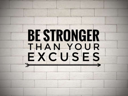 Motivational and inspirational quote - 'Be stronger than your excuses' written on white blurred wall background.