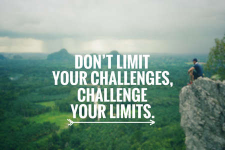 Motivational and inspirational quote - Don't limit your challenges, challenge your limits. Blurred vintage styled background.