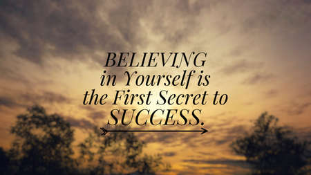 Motivational and inspirational quote - Believing in yourself is the first secret to success. Blurred styled background. Stock Photo