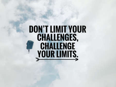 Motivational and inspirational quote - Don't limit your challenges, challenge your limits. Blurred styled background.