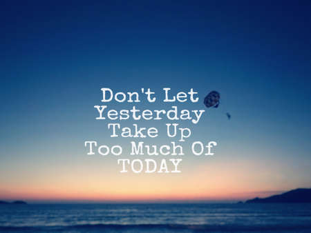 Motivational and inspirational quote - Don't  let yesterday take up too much of today. Blurred styled background.