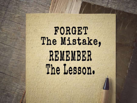 Motivational and inspirational wording - Forget The Mistake, Remember The Lesson. Blurred vintage styled background. Banco de Imagens