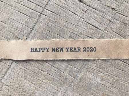 New Year concept  - Happy New Year 2020 written on a ripped white paper. Blurred styled background. Reklamní fotografie