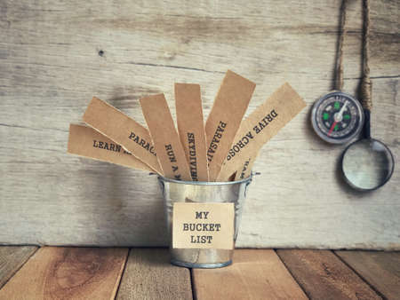 Motivational and inspirational concept - My Bucket List written on paper. Blurred vintage styled background. Imagens