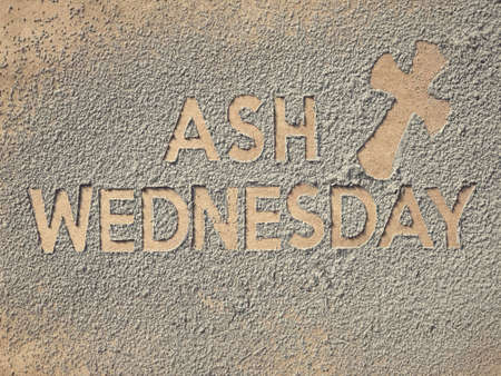 Ash Wednesday concept - Ash Wednesday words and a cross formed out of ashes.