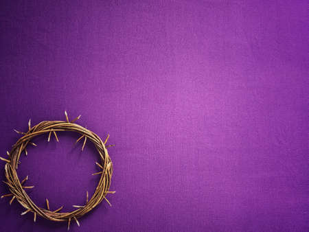 Good Friday, Lent Season and Holy Week concept - A woven crown of thorns on purple background. Stock Photo
