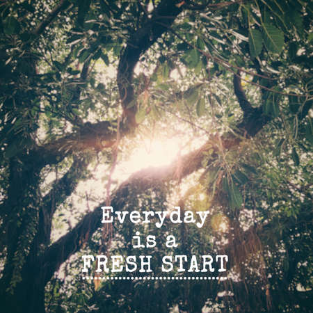 Motivational and inspirational quote - Everyday is a Fresh Start. Blurred styled background.