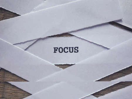 Motivational and inspirational word - FOCUS written on a ripped paper. Stock Photo