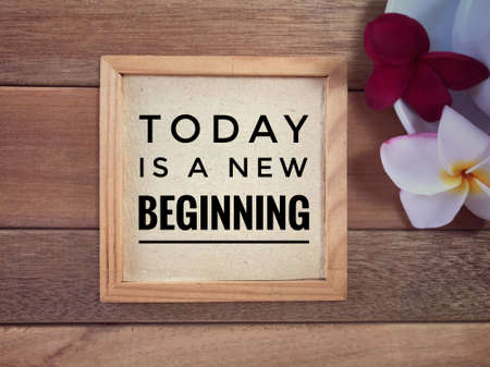 Motivational and inspirational quote - Today Is A New Beginning written on a framed paper.