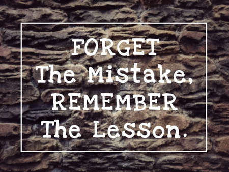 Motivational and inspirational quote - Forget The Mistake, Remember The Lesson. Blurred styled background.