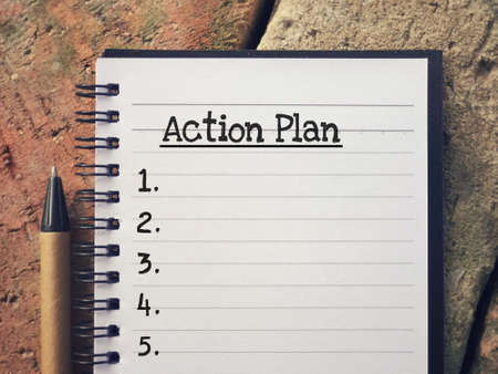 New Year Plan concept - Action Plan written on a notepad.