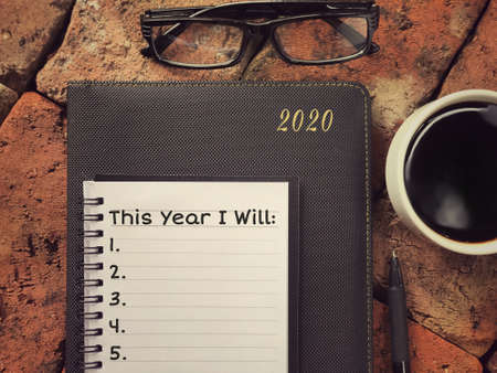 New Year resolution concept - This Year I Will written on a notebook.