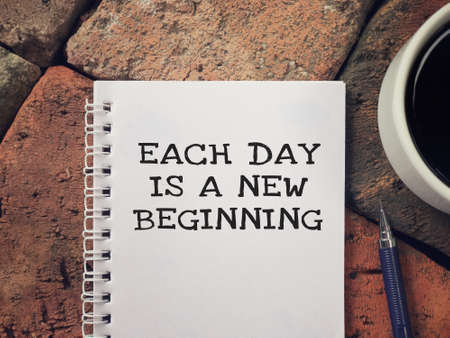 Motivational and inspirational wording - Each Day Is A New Beginning written on a notebook. Stock Photo