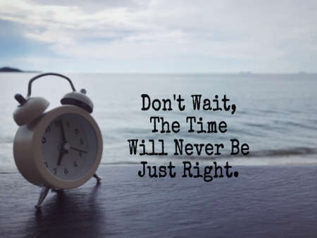 Motivational and inspirational wording - Don't Wait, The Time Will Never Be Just Right. Blurred styled background. Archivio Fotografico