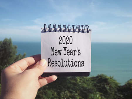 New Year's resolution concept - 2020 New Year's Resolutions written on a notepad. Stock Photo