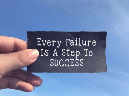 Motivational and inspirational quote - Every Failure Is A Step To Success written on a paper. Stock Photo